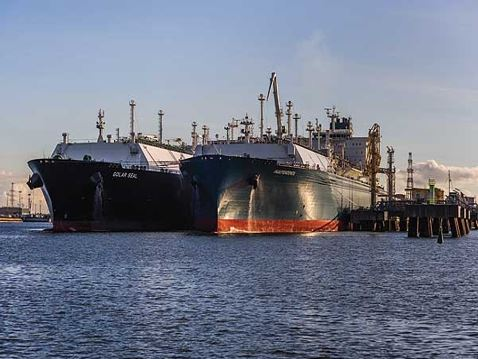 LNG is transferred from tanker to a stationary floating terminal