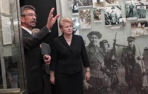 KGB Museum (Genocido Auku Muziejus): KGB museum director E.Peikstenis and Lithuania president D.Grybauskaite at KGB museum
